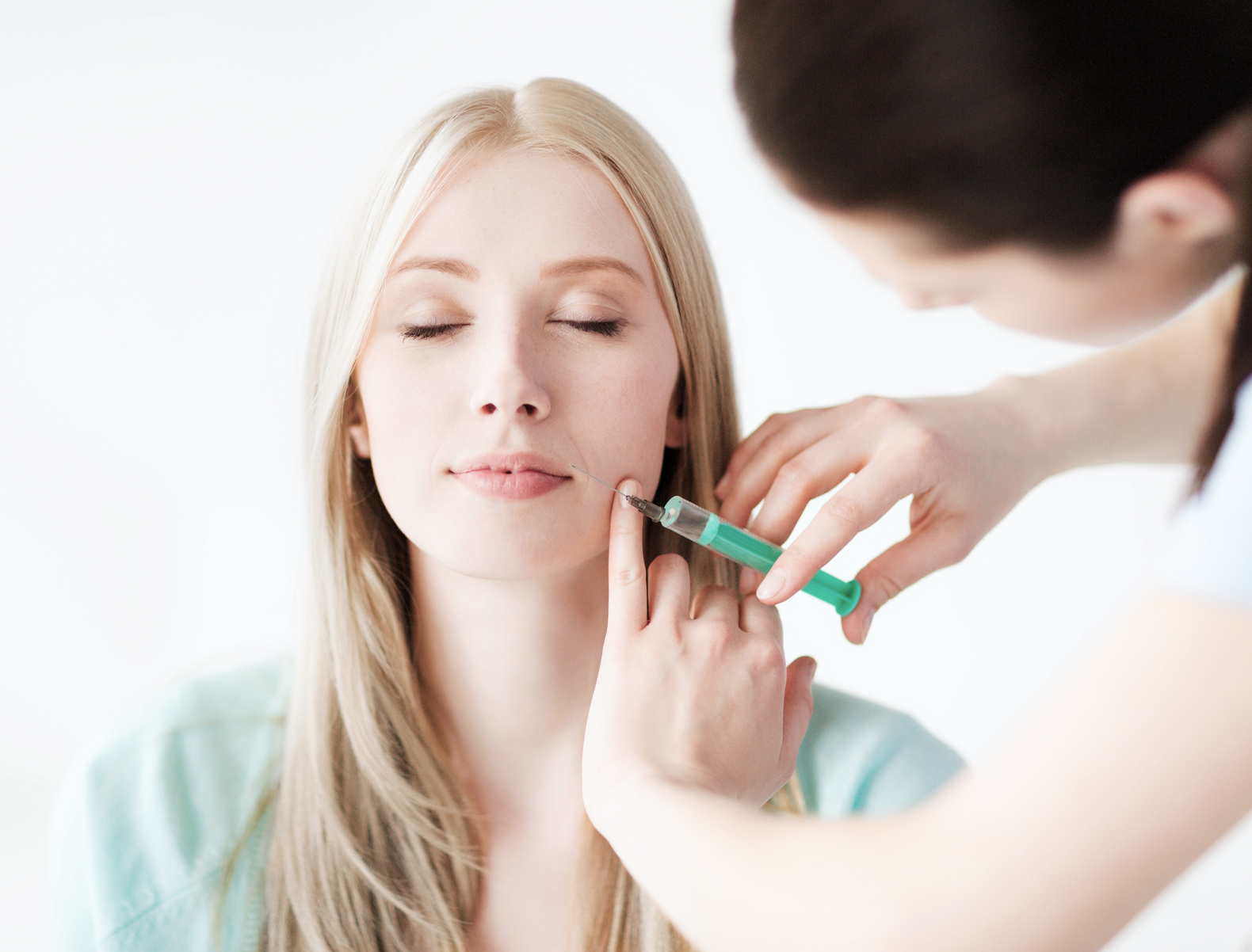 beautician with patient doing botox injection | fresh dental smile clinic - dentists in York